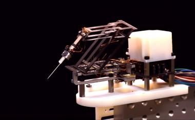 Origami-inspired miniature manipulator for microsurgery