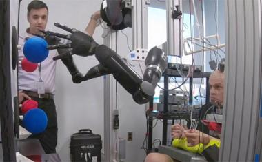Quadriplegic controls two prosthetics with thoughts