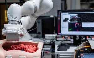 Robot navigates ultrasound pill through colon