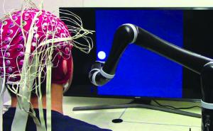 A mind-controlled robotic arm without brain implants