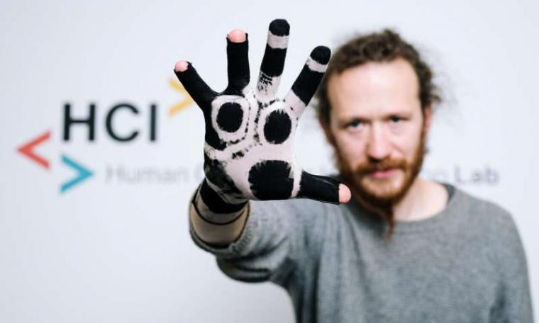 Polymerized glove that can be used to digitally capture hand movements.