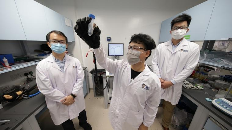 Doctoral student Yang Haitao (centre) demonstrating a soft robotic...