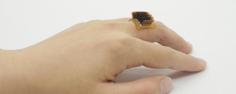 A thermoelectric wearable device worn as a ring.
