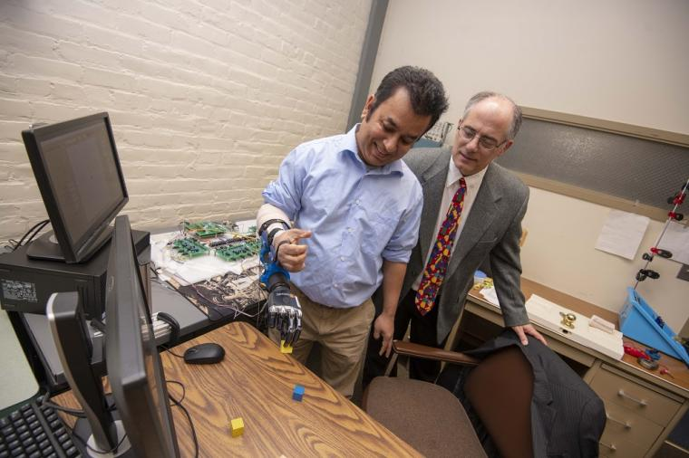 Ted Clancy (right), professor of electrical and computer engineering at WPI, is...