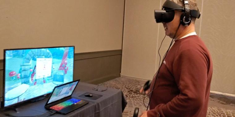A user tries out the virtual reality game Through the Looking Glass, which U of...