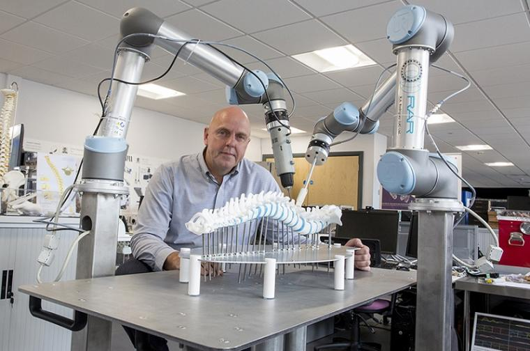 Prof Philip Breedon with two robot arms.