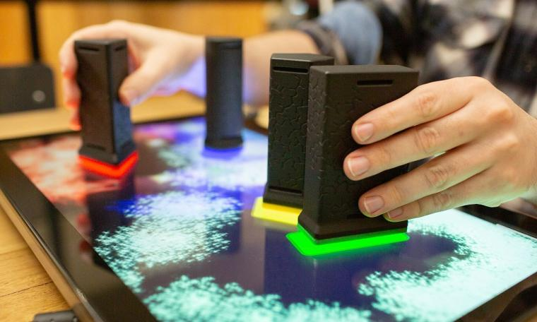 Stroke patients can complete therapeutic games via an interactive touchscreen...
