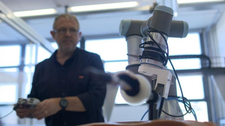 The system will allow for a robotic arm to control the handler that the second...