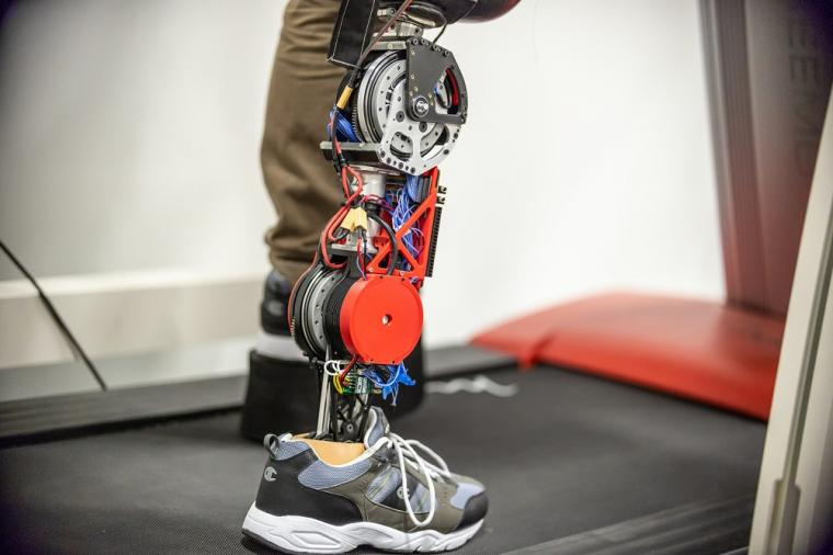 The strong motors powering the knee and ankle can propel the user's body...