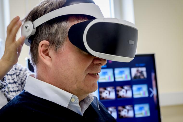 Using VR headsets, healthcare professionals are able to conduct interviews with...