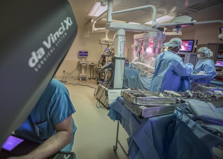 Surgical team conducts a robotic surgery