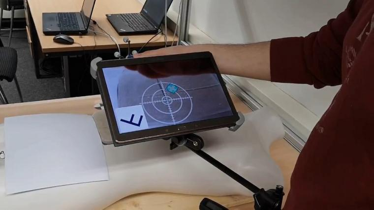 Navigation support using a tablet computer (video-see-through AR). The planned...
